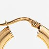 A pair of 14k gold earrings. unoaerre.