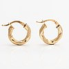 A pair of 14k gold earrings.