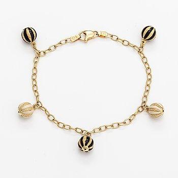A 14K gold and enamel bracelet. Unoaerre, Italy.