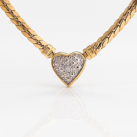 A 14k gold neckalce with a diamond ca. 0.005 ct.