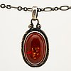 Georg jensen, pendant with chain, sterling silver and amber approx 18 x 10 mm, length approx 48 cm.