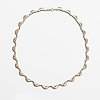 A platinum and 18k gold necklace.