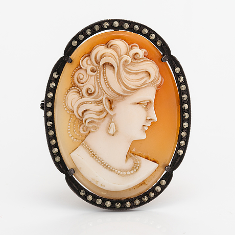A silver and sea shell cameo brooch/pendant wtih marcasites.