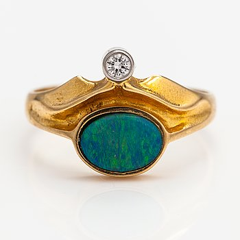 Zoltan Popovits, An 18K gold ring with a opal dublé and a ca. 0.04 ct diamond according to engraving. Lapponia 1981.