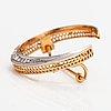 An 18k gold brooch ith rose-cut diamonds.