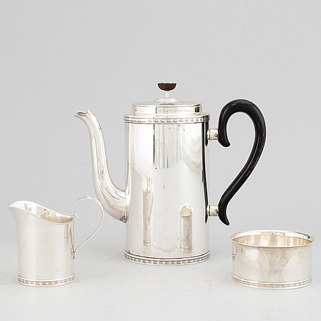 Vera ferngren, a silver coffee pot, creamer and sugar bowl, cg hallberg, stockholm 1958.