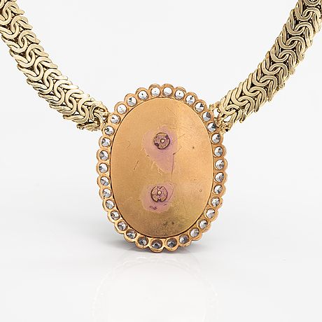 A 14k and 18k gold necklace with a spactrolite, rose-cut diamonds and synthetic spinelles.