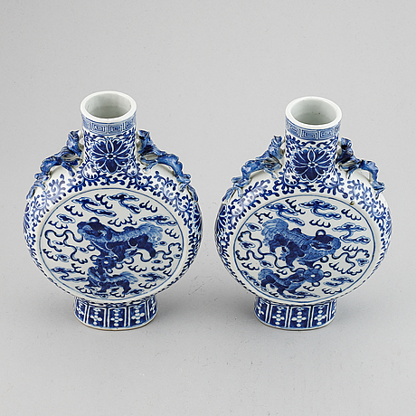 A pair of blue and white moon flasks, qing dynasty, 19th century.