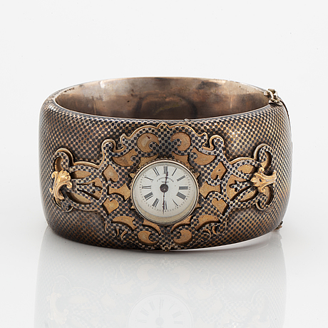 Silver bangle with watch.