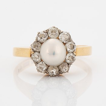 An old-cut diamond and pearl ring.