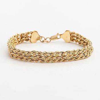 A 14K gold bracelet. Finnish import marks.