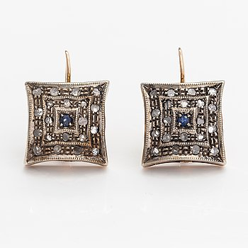A pair of 14K gold earrings with rose-cut diamonds and sapphires.
