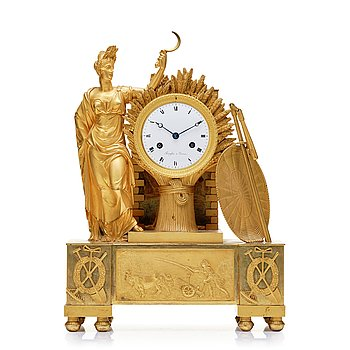 110. A French Empire 19th century gilt bronze mantel clock by Rieussec.
