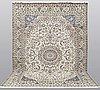 A carpet, nain part silk, 364 x 256 cm.