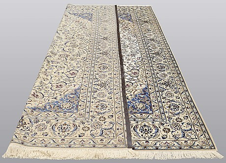 A carpet, nain part silk, 364 x 256 cm.