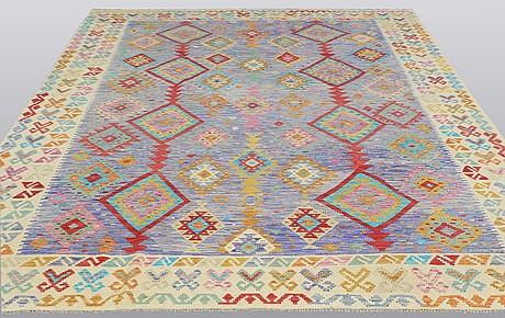A kelim carpet, 340 x 260 cm.