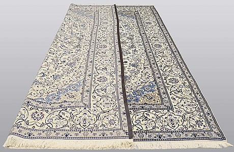 A carpet, nain part silk s.k 9laa, ca  417 x 287 cm.