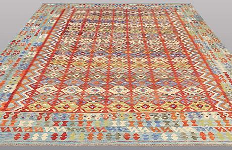 A carpet, kilim, ca 394 x 307 cm.