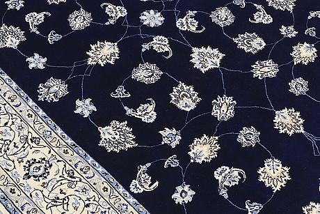A carpet, nain part silk s.k 9laa, ca 312 x 199 cm.