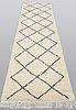 A moroccan runner carpet, 310 x 82 cm.