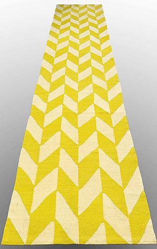 A runner, flat weave, ca  487 x 85 cm.
