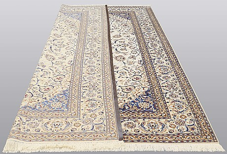 A carpet, nain part silk, 361 x 262 cm.