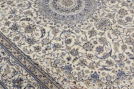A carpet, nain part silk, 405 x 304 cm.