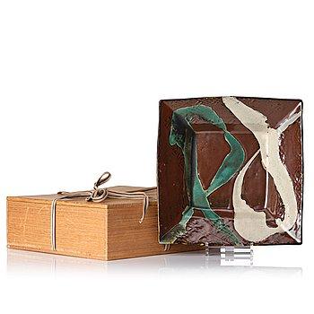 138. Shoji Hamada, a square stoneware dish, Japan 1950-60's, with signed wooden box.