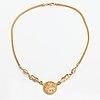"""Kalevala koru, an 18k gold necklace """"sun lion"""". helsinki 2005."""