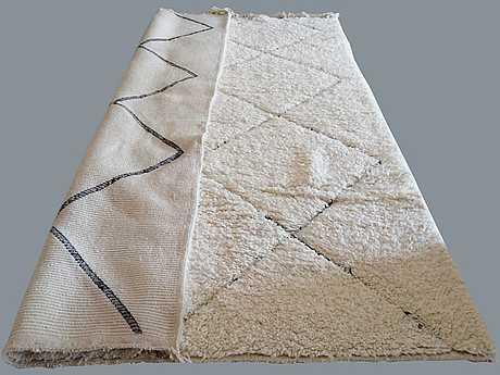 A carpet, morocco, ca 300 x 200 cm.