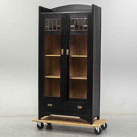 An early 20th century art noveau cupboard.