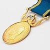 23k and 18k gold medal.