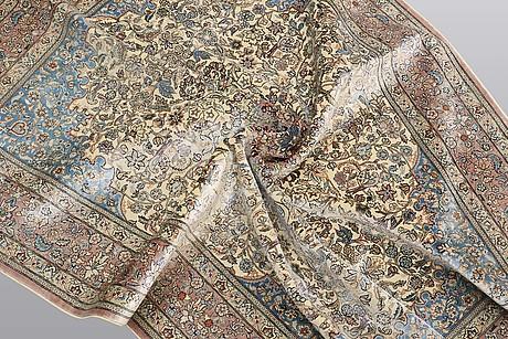 A rug, figural oriental silk,  signed, ca 175 x 125 cm.
