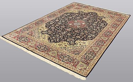 A carpet, 280 x 185 cm.