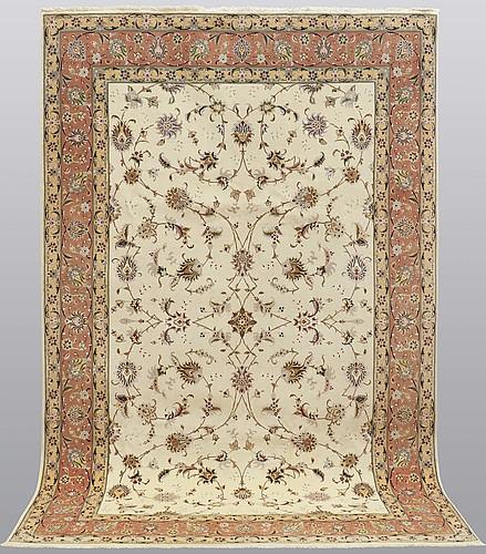 A carpet, tabriz part silk, so called 50 radj, ca 310 x 202 cm.