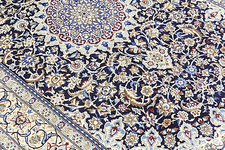 A carpet, nain part silk so called 9 laa, ca 322 x 211 cm.