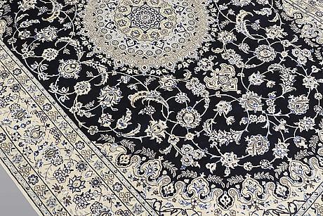 A carpet, nain part silk, s.k 9laa, ca 308 x 201 cm.