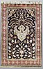 A rug, silk qum, ca 170 x 105 cm.