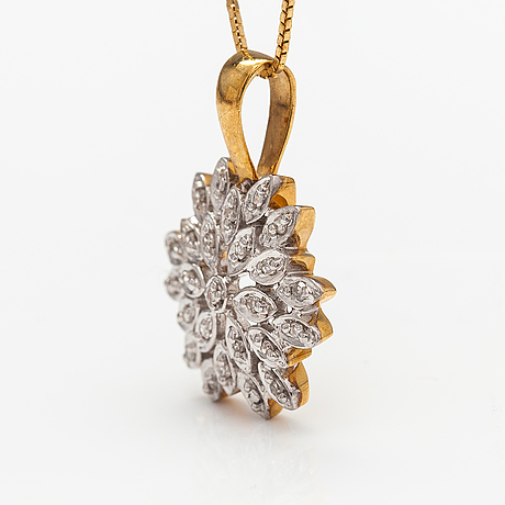 A 14k and 18k gold jewellery suite with diamonds ca. 0.30 ct in total.