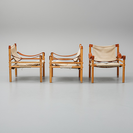 "Arne norell, a set of three ""sirocco"" armchairs and two tables, norell."