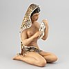 "Le bertetti, a ""jungla"" ceramic figurine of a seated woman with a rabbit, torino, italy mid 20th century."
