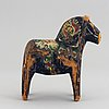 A set of 4 painted wooden horses from the first half of the 20th century.