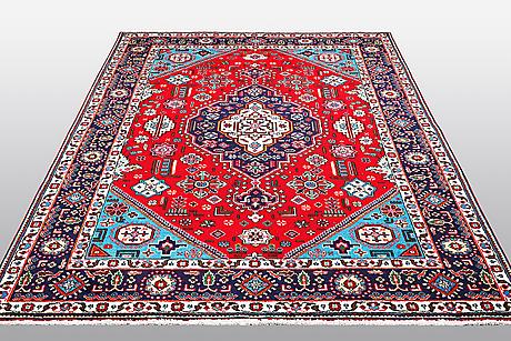 A carpet, tabriz, ca 298 x 198 cm.