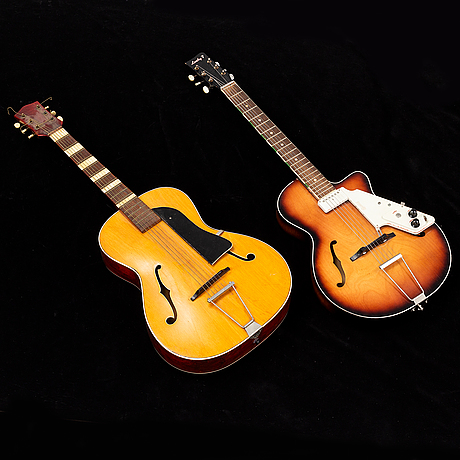 2 semi acoustic guitars, egmond lucky 7 and one without brand.