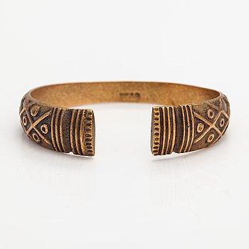 """A bronze bracelet """"Vörå bracelet"""", model 207. Kalevala Koru, Helsinki 1940's."""