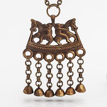 "A bronze necklace ""Two riders"", model 75. Kalevala Koru, Helsinki."