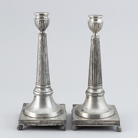 A pair of late gustavian pewter candlesticks by martin artedius, mariestad (master 1808-1838).