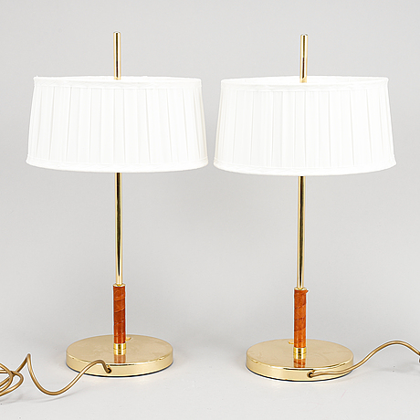 A pair of brass and leather table lights.