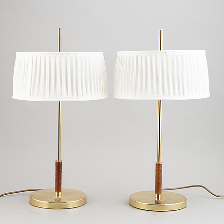 A pair of brass and leather table lights, 21 century.