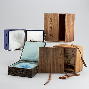 A set of seven Chinese and Japanese boxes, wood or textile clad, 19th/20th Century.